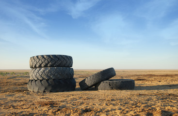 Photo of five old vehicle tires outdoors