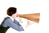 A business woman shouting into a old style megaphone