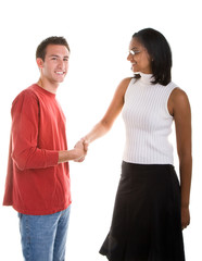 A woman dressed in business attire shaking hands