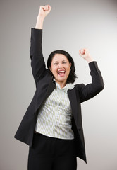 Excited businesswoman cheering and celebrating her success