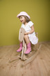 Little girl playing with rocking horse