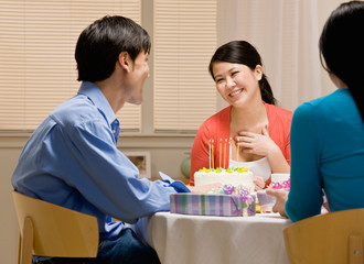 Woman thanking husband for birthday cake at birthday party