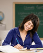 Student with text books doing homework in classroom