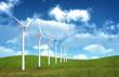 Wind farm  in grass over blue sky
