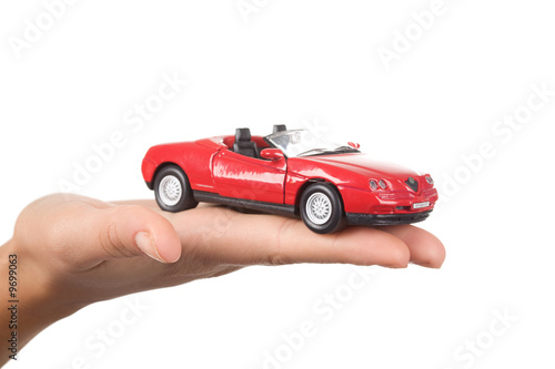 Close-up of red toy car on female's palm - 9699063