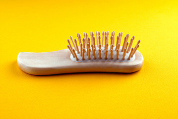 hairbrush on  yellow background