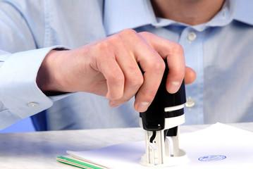 businessman seals on  document, close up