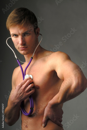Young  man with  medical stethoscope in  hand