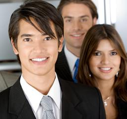 Friendly business man portrait - smiling eith his team