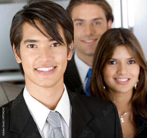 Friendly business man portrait - smiling eith his team