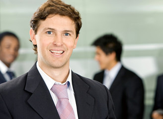confident business man smiling in his office