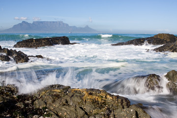 Table Mountain from Bloubergstrand with rocks in the foreground