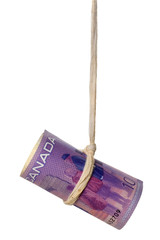 Dangling Canadian dollar held by a rope isolated on white