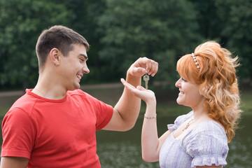 Man handing a woman keys
