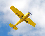 Small private airplane passing overhead poster