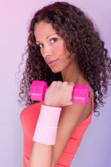 Pretty curls hair girl holding weight for exercise