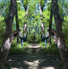 Some identical girls on a wood footpath