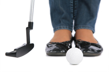 woman Feet, stick and ball for golf