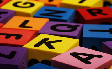 A set of colorful foam alphabet letter blocks