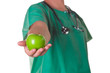Doctor with a green apple on his hand