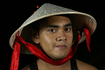 Asian man with  conical hat