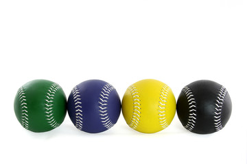 Four Softballs in a row green blue yellow and black