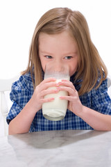 School Girl Drinking Glass Of Milk