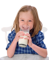 Smiling School Girl Drinking Milk