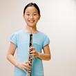 Confident musician holding clarinet