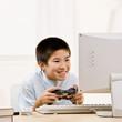 Boy holding video game controller having fun playing video game