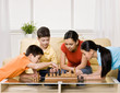 Friends gathering in livingroom to play chess