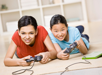 Friends having fun using video game controllers