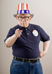 Patriotic man in American flag hat and vote button