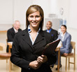 Confident businesswoman with notebook