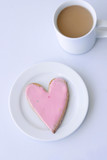 Heart biscuit and a cup of coffee