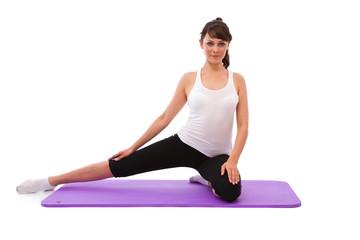 beautiful woman having a sports workout on white