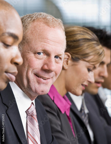 Close up of multi-ethnic co-workers sitting in a row