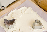 Image of cookie making with molds and pastry. poster