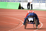 Image of disabled athletes competing in a wheel chair race. poster