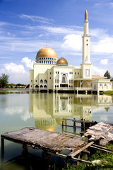 Floating mosque with gold coloured domes in Malaysia.