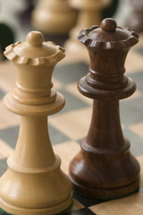 two chess pieceson a chessboard