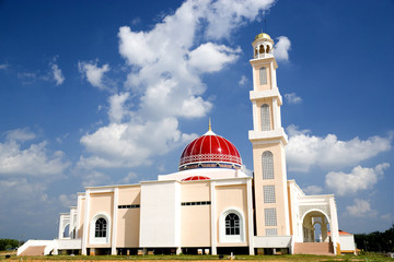 A modern red domed mosque in Malaysia.