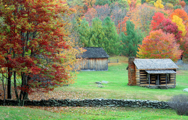 Autumn mountain colors and cabin