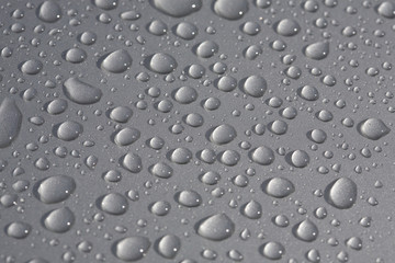 rain drops on metallic surface