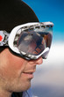 Face shot of snowboarder wearing goggles - profile