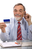 Businessman making a credit card purchase by phone poster