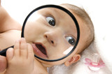 baby's magnified face isolated on white background