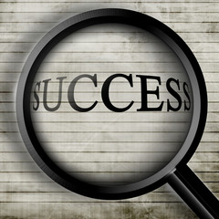 Success seen through a magnifier on old paper
