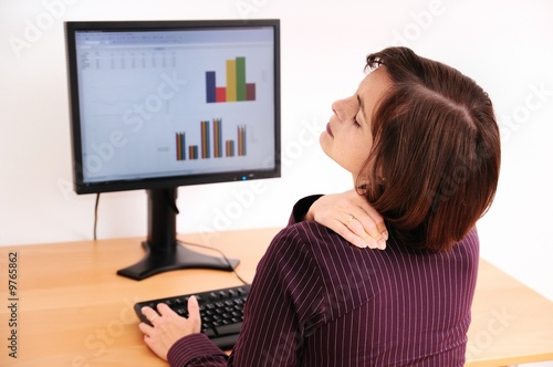 Business woman with neck pain. Focus on hand.