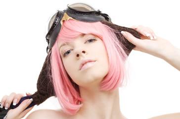 pink hair girl in aviator helmet over white